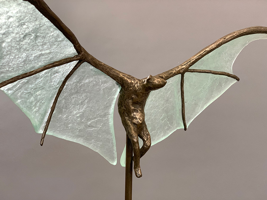 "Bat with Pale Green Wings, 2021, Bronze, cast lead glass, steel base, 24""h x 21""l x 9""d. ©Tritscheller"